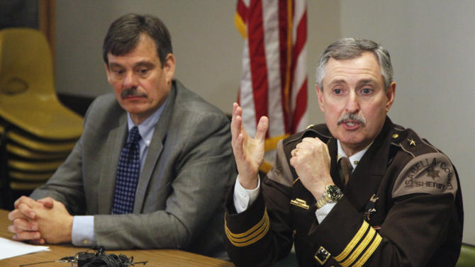 Isabella County Sheriff Leo Mioduszewski, right, and Central Michigan University Police Chief Bill Yeagley meet with reporters at the Isabella County Courthouse on Thursday, Jan. 17, 2013, in regards to the abduction at gunpoint of a female Central Michigan University student Wednesday evening.  Police said the woman is safe. (AP Photo/The Saginaw News, Rachel Sonnenshine) ALL LOCAL TV OUT; LOCAL TV INTERNET OUT