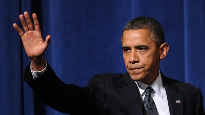 President Obama waves after speaking at an interfaith vigil in Newtown, Conn., on Dec. 16.
