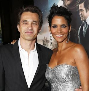 "FILE - This Oct. 24, 2012 file photo shows actors Olivier Martinez, left, and Halle Berry at the Los Angeles premiere of Berry's film,  ""Cloud Atlas,"" in the Hollywood section of Los Angeles. A representative for the 46-year-old actress confirms that Berry and her fiance, Olivier Martinez, are expecting their first child together. Berry and Martinez announced their engagement last year. Berry has a four-year-old daughter, Nahla, with ex-boyfriend Gabriel Aubry.  (Photo by Todd Williamson/Invision/AP, file)"