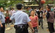 China: Ai Weiwei Films Violent Street Brawl
