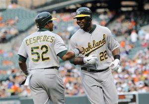 Athletics use 6-run 9th to beat Orioles 14-9