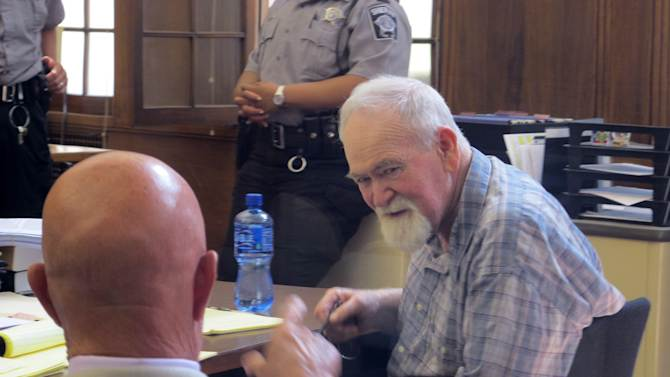 John Henry Spooner, 76, right, confers with his defense attorney Monday, July 15, 2013, during a break in jury selection for his trial on charges that he fatally shot a black teen last year whom he suspected of breaking into his Milwaukee home and stealing weapons. The case has drawn comparisons to the trial of George Zimmerman, who was acquitted two days earlier of killing Trayvon Martin in Sanford, Fla., last year. (AP Photo/Dinesh Ramde)