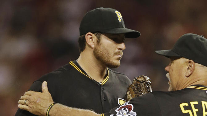 Pittsburgh Pirates relief pitcher Bryan Morris, left,  talks with pitching coach Ray Searage in the eighth inning of a baseball game, Monday, June 17, 2013, in Cincinnati. Morris gave up two home runs in the inning. Cincinnati won 4-1. (AP Photo/Al Behrman)