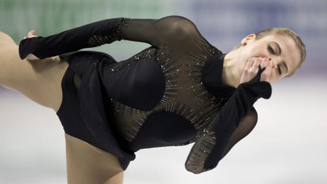 Women's silver medalist Carolina Kostner from the Italy hold her nose to stop the it from bleeding as she performs her free skate in the women's competition at the World Figure Skating Championships on Saturday, March 16, 2013, in London, Ontario. (AP Photo/The Canadian Press, Paul Chiasson)