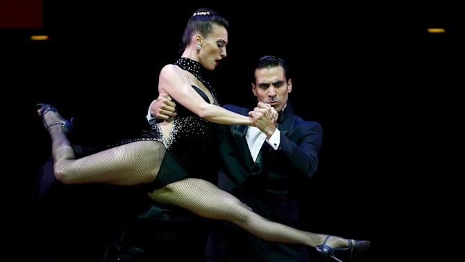 Tango couple Barbadori and Agudo from Argentina dance during the Stage style final round at the Tango World Championship in Buenos Aires