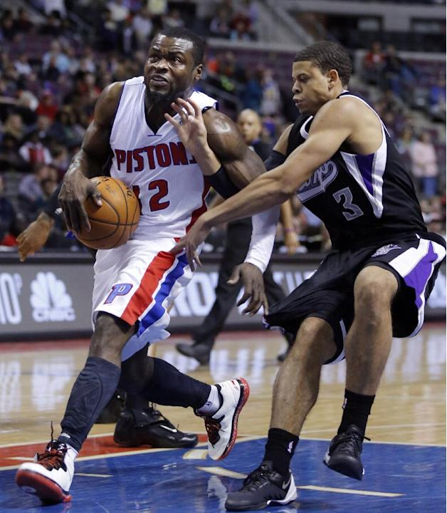 Detroit Pistons guard Will Bynum, left, drives to the basket past Sacramento Kings guard Ray McCallum (3) during the second half of an NBA basketball game Tuesday, March 11, 2014, in Auburn Hills, Mic