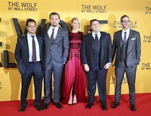 "Producer Riza Aziz (L-R), cast members Leonardo DiCaprio, Margot Robbie, Jonah Hill and producer Joey McFarland arrive for the U.K. Premiere of ""The Wolf of Wall Street"" at Leicester Square, in London January 9, 2014. REUTERS/Paul Hackett"