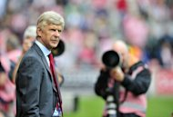 Arsenal manager Arsene Wenger ahead of the English Premier League match against Stoke City on August 26. Wenger insists Arsenal will find a way to replace Robin van Persie despite being held to a second straight goalless draw, by Stoke, at the start of the Premier League season