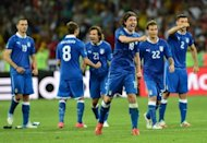 Italian players celebrate during the penalty shoot out of the Euro 2012 football championships quarter-final match England vs Italy at the Olympic Stadium in Kiev. England's penalty curse struck again here Sunday as Italy advanced to the semi-finals of Euro 2012 with victory in a shoot-out after a tense quarter-final duel finished 0-0 following extra-time