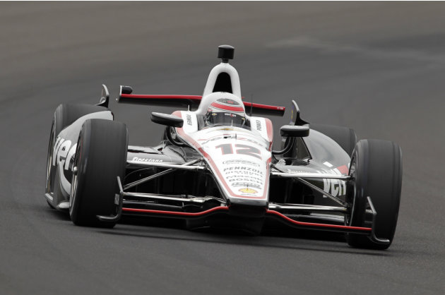 Will Power, of Australia, drives through the first turn on his qualification run on the first day of qualifications for the Indianapolis 500 auto race at Indianapolis Motor Speedway in Indianapolis, S