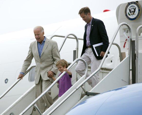 Vice President Joe Biden arrives at Harrisburg International Airport with his grandson Hunter Biden and son Beau Biden, right, Sunday, Sept. 2, 2012, in Middletown, Pa.