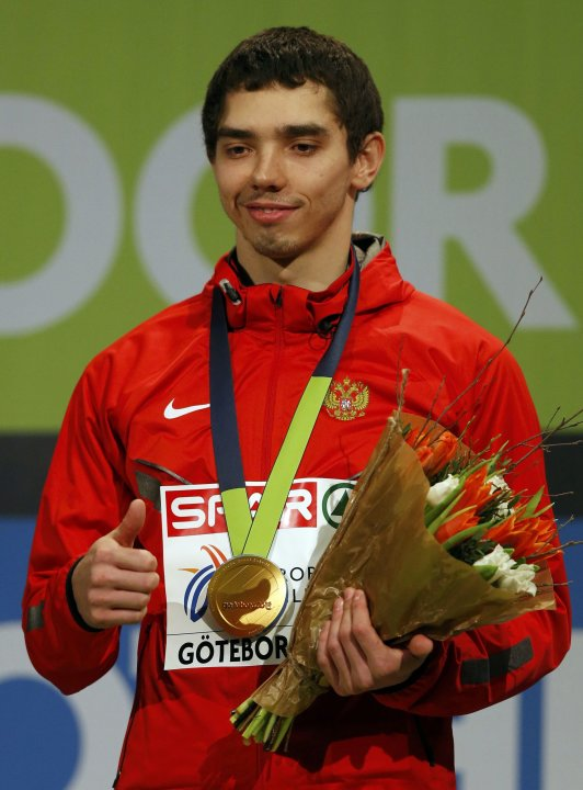 Winner Menkov of Russia celebrates on the podium after the men's Long Jump final at the European Athletics Indoor Championships in Gothenburg
