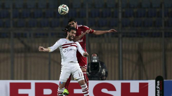 Bassem Mursi of al-Zamalik and Mohamed Naguib of al-Ahly jump for a header during their Egyptian Premier League soccer match in Cairo