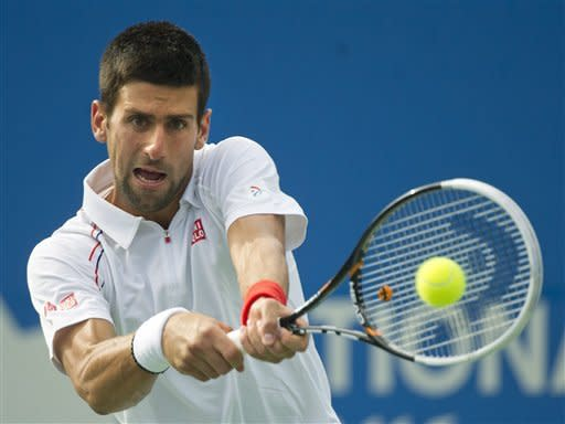Top-seeded Djokovic advances in rainy Toronto