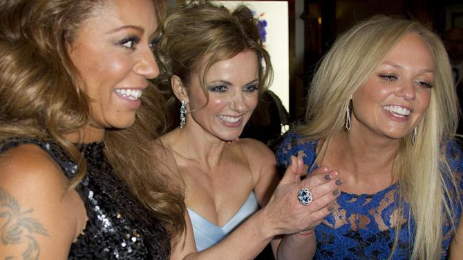 From left, Mel B, Geri Halliwell and Emma Bunton arrive for the press showing of Viva Forever!, a musical based on the songs of the Spice Girls, at a theater in central London, Tuesday, Dec. 11, 2012. (Photo by Joel Ryan/Invision/AP)