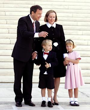 FILE - In this Oct. 3, 2005 file photo, Supreme Court Chief Justice John Roberts, left, stands with his family, wife Jane, daughter Josie, right, and son Jack, in front of the Supreme Court in Washington. With their Ivy League pedigrees and East Coast addresses, Supreme Court justices often are rightly described as unrepresentative of the nation. But in one area, the justices look a lot like the rest of America. Members of the court have first-hand experience with divorce and adoption, as well as making it alone without ever getting married. Just five of the nine justices have been married once and have had biological children with their spouses.  (AP Photo/Manuel Balce Ceneta, File)