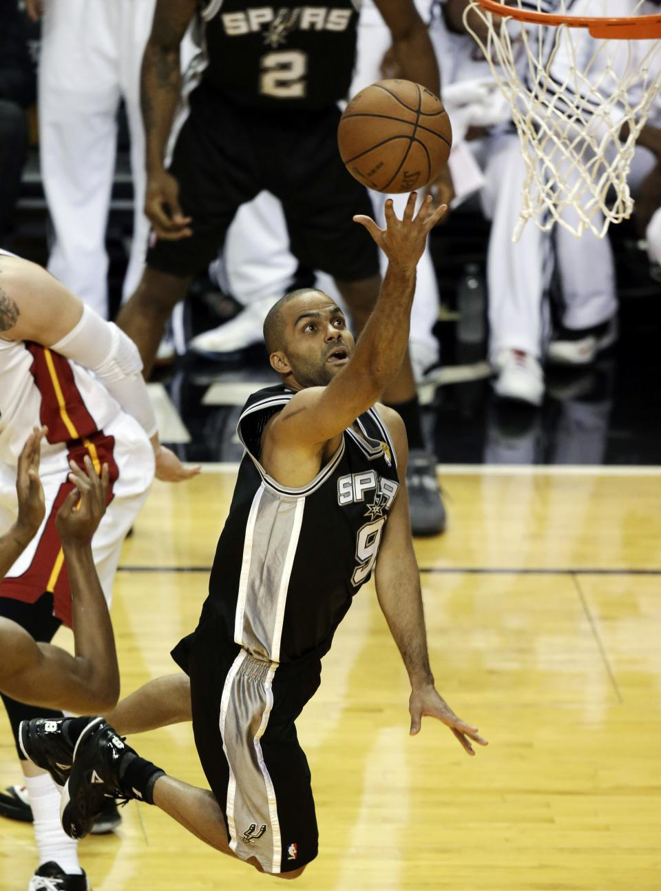 San Antonio Spurs guard Tony Parker (9) drives to the basket during the first half of Game 6 in their NBA Finals basketball series against the Miami Heat, Tuesday, June 18, 2013 in Miami. (AP Photo/Wilfredo Lee)