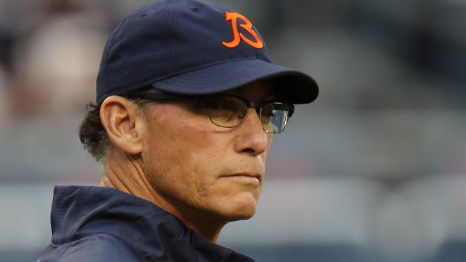 Bears' coach Marc Trestman watches his team warm up before the start of a pre-season NFL football game against the Chargers in Chicago