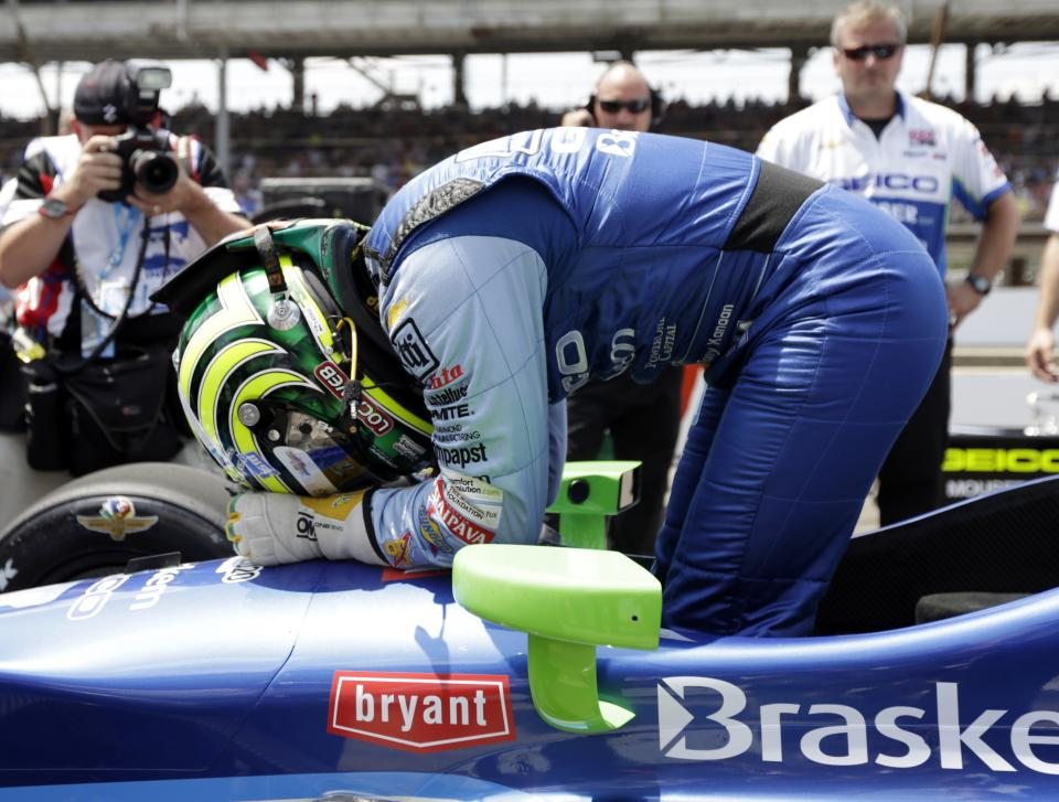 IndyCar driver Tony Kanaan, of Brazil, reacts after qualifying his car on his second attempt on the first day of qualifications for the Indianapolis 500 auto race at the Indianapolis Motor Speedway in Indianapolis, Saturday, May 19, 2012. (AP Photo/AJ Mast)