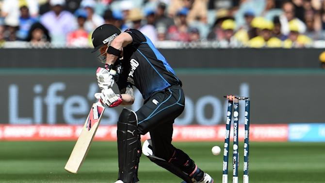 New Zealand captain Brendon McCullum is bowled by Australia's Mitchell Starc for a duck during the Cricket World Cup final in Melbourne on March 29, 2015