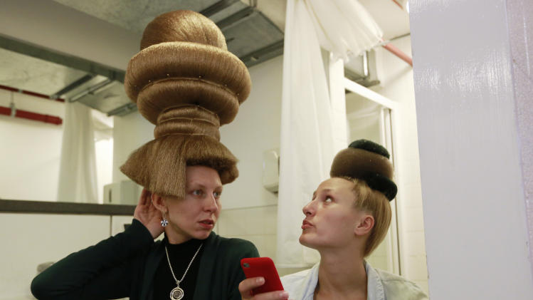Models for hair stylist Mario Krankl wait backstage at the 30th anniversary of the Alternative Hair Show at the Royal Albert Hall in London