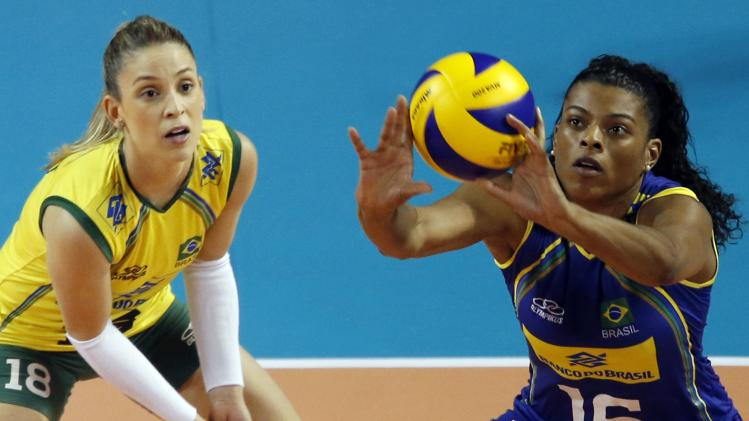 Fernanda Rodrigues of Brazil receives a serve from China next to Camila Brait during their FIVB Women's Volleyball World Grand Prix 2014 final round match in Tokyo
