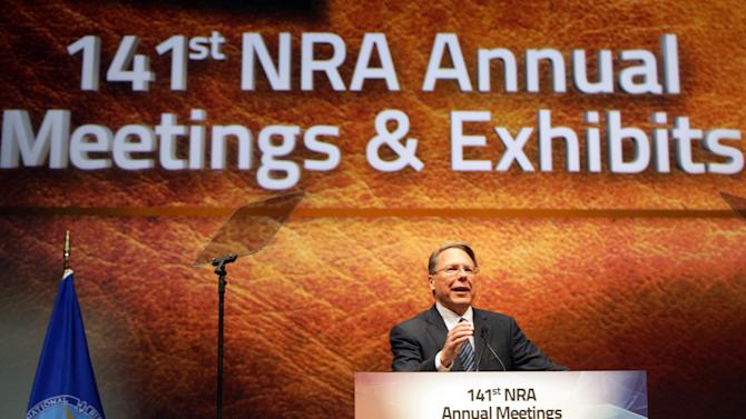 FILE - In this April 14, 2012, file photo, Wayne LaPierre Jr., Executive Vice President and Chief Executive Officer of the National Rifle Association speaks at its members annual meeting during its national convention in St. Louis. LaPierre, 63, has been serving up heated us-vs.-them rhetoric to rally the NRA faithful. Usually it works; sometimes it backfires. He has had a surprisingly long run surviving insider plots along the way, and remains the hero to many a gun lover, and villain to the opposing forces. (AP Photo/St. Louis Post-Dispatch, Christian Gooden)