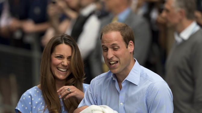 Britain's Prince William and Kate, Duchess of Cambridge react, as they talk to the media whilst holding the Prince of Cambridge, Tuesday July 23, 2013, after posing for photographers outside St. Mary's Hospital exclusive Lindo Wing in London where the Duchess gave birth on Monday July 22. The Royal couple are expected to head to London's Kensington Palace from the hospital with their newly born son, the third in line to the British throne. (AP Photo/Matt Dunham)