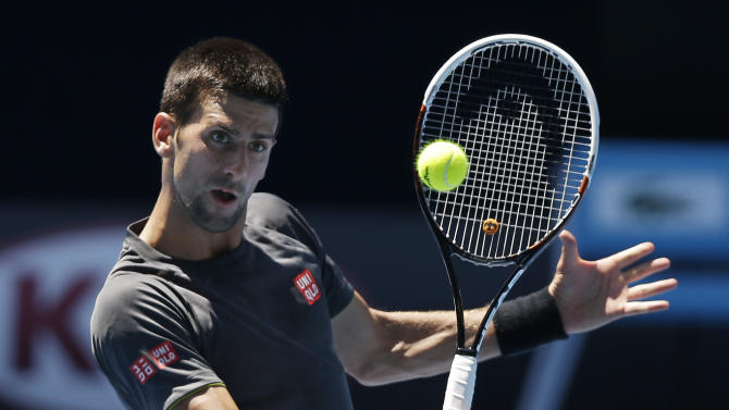 Serbia's Novak Djokovic makes a backhand volley return during a practice session at Melbourne Park as he prepares for next week's Australian Open tennis championship in Melbourne, Australia, Thursday, Jan. 10, 2013. (AP Photo/Mark Baker)