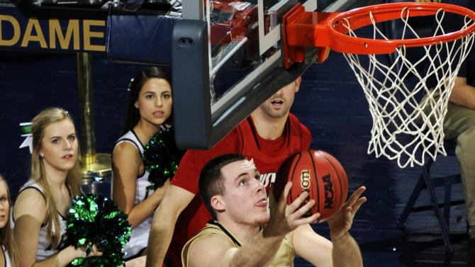 Notre Dame guard Pat Connaughton shoots in overtime of their NCAA college basketball game against Louisville, Saturday, Feb. 9, 2013, in South Bend, Ind. Notre Dame won 104-101 in five overtimes. (AP Photo/Joe Raymond)