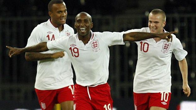 England's Jermain Defoe (C) celebrates with team mates Ryan Bertrand (L) and Tom Cleverley after scoring against Italy during their international friendly soccer match in Bern August 15, 2012 (Reuters)