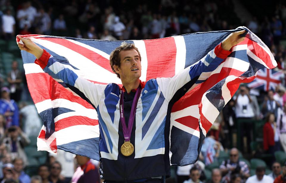 Gold medalist Andy Murray of Great Britain waves the British flag during the medal ceremony of the men's singles event at the All England Lawn Tennis Club at Wimbledon, in London, at the 2012 Summer Olympics, Sunday, Aug. 5, 2012. (AP Photo/Elise Amendola)
