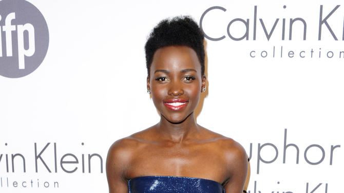 """FILE - This May 15, 2014 file photo shows Lupita Nyong'o at the IFP and Calvin Klein Women In Film Party at the 67th international film festival, Cannes, southern France. The Walt Disney Co. announced Monday, June 2, that Nyong'o is joining the cast of """"Star Wars: Episode VII."""" The 31-year-old actress became a breakthrough star for her award-winning performance in """"12 Years a Slave."""" (AP Photo/Arthur Mola/Invision/File)"""