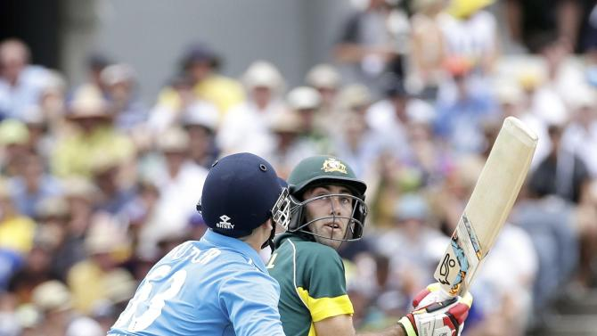 Australia's Glenn Maxwell plays the ball past England's Jos Buttler during their One Day International tri-series cricket final match at the WACA ground