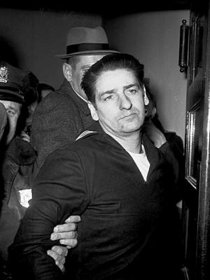 FILE - This Feb. 25, 1967, file photo shows self-confessed Boston Strangler Albert DeSalvo minutes after his capture in Boston. DeSalvo confessed to the string of 1960s killings but was never convicted. He died in prison in the 1970s. Massachusetts officials said Thursday, July 11, 2013, that DNA technology led to a breakthrough, putting them in a position to formally charge the Boston Strangler with the murder of Mary Sullivan, last of the slayings attributed to the Boston Strangler. (AP Photo, File)