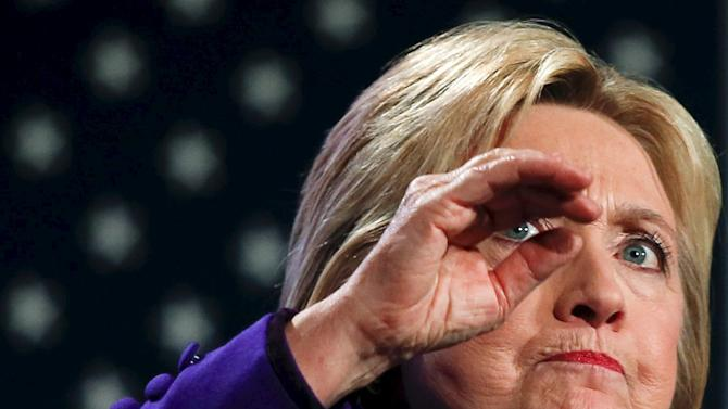 Democratic U.S. presidential candidate Hillary Clinton gestures while speaking at the 2016 McIntyre Shaheen 100 Club Celebration in Manchester, New Hampshire