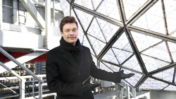 """FILE - In this Friday, Dec. 28, 2012 file photo, Ryan Seacrest, producer and host of Dick Clark's New Year's Rockin' Eve on ABC, poses for a portrait, in New York. ABC devoted its entire prime-time schedule on Tuesday, Dec. 31, 2013, to Seacrest's """"New Year's Rockin' Eve."""" During the 10 p.m. hour as the ball dropping came near, Seacrest's show had more than twice as many viewers as Carson Daly's competing show on NBC. (Photo by Dan Hallman/Invision/AP, File)"""