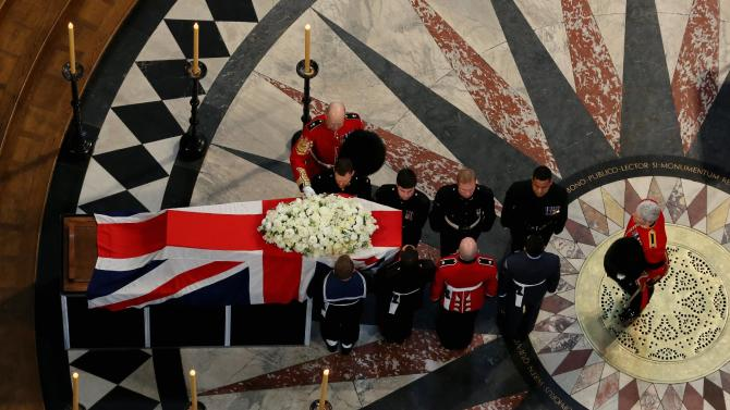 The coffin containing the body of former British Prime Minister Margaret Thatcher leaves the ceremonial funeral at St Paul's Cathedral in London, Wednesday April 17, 2013. World leaders and dignitaries from 170 countries are due to attend the funeral of former British Prime Minister Margaret Thatcher on Wednesday, an elaborate affair with full military honors that will culminate in a service at St. Paul's Cathedral in London. (AP Photo/Gareth Fuller, Pool)