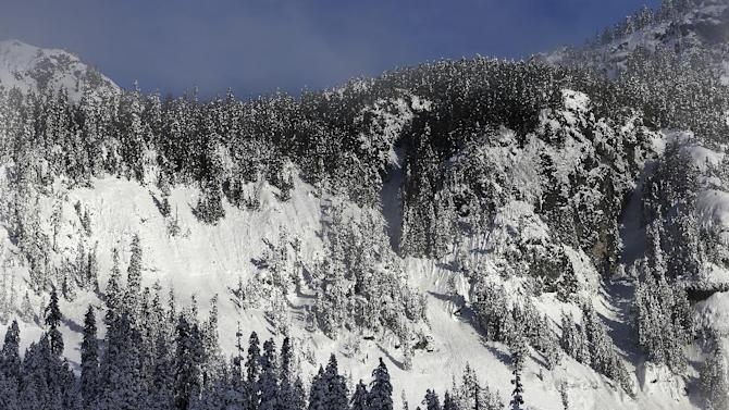 In this Jan. 4, 2013 photo, evidence of sliding snow is seen in steep terrain near a ski area at Snoqualmie Pass in Washington state. Where backcountry safety education once stressed the mechanics of avalanches and snow science, training courses now incorporate a focus on human factors such as how to make better decisions, manage group dynamics and speak up should danger arise. (AP Photo/Ted S. Warren)