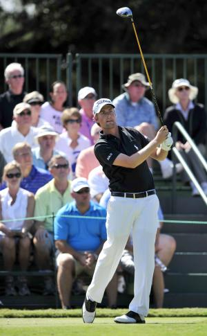 Webb Simpson watches his drive off the 1st tee during the third round of the McGladrey Classic golf tournament at the Sea Island Golf Club on St. Simons Island, Ga., Saturday, Oct. 15, 2011. (AP Photo/Stephen Morton)