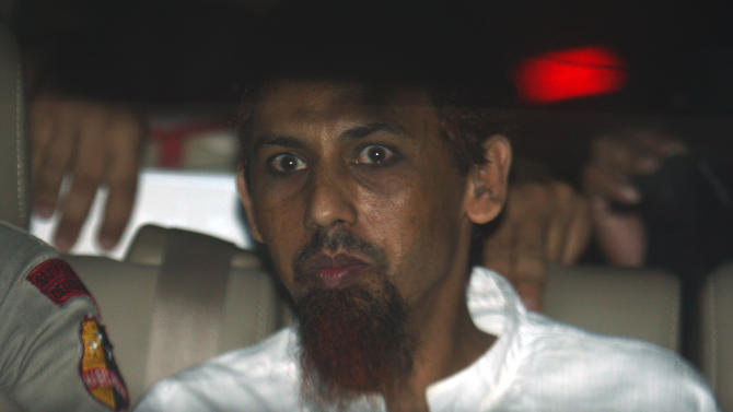 Indonesian Muslim militant Umar Patek sits inside a police van as he leaves West Jakarta district court after his hearing in Jakarta, Indonesia, Monday, May 21, 2012. Prosecutors are seeking life in prison for Patek who was accused of building the car bomb used in the 2002 Bali nightclub attacks. (AP Photo/Tatan Syuflana)