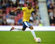 Brazilian midfielder Lucas Moura controls the ball during the London 2012 Olympic games warm up football match between Great Britain and Brazil at the Riverside stadium in Middlesbrough, north-east England on July 20. Manchester United manager Sir Alex Ferguson has confirmed his interest in Lucas. (AFP Photo/Andrew Yates)
