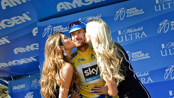 Bradley Wiggins receives kisses retaining the yellow jersey following the fourth stage of the Amgen Tour of California cycling race in Cambria, Calif., on Wednesday, May 14, 2014