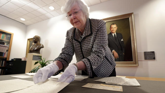 """Archivist Claudia Anderson handles some of the love letters exchanged between Lyndon Johnson, then a 26-year-old congressional aide, and Claudia Alta """"Lady Bird"""" Taylor, then 21, at the LBJ Presidential Library at the University of Texas, Wednesday, Feb. 13, 2013, in Austin, Texas. For the first time, the entire collection of nearly 100 love letters written between Lyndon Johnson and Lady Bird Johnson during their 21/2-month courtship in 1934 is being made available to the public, beginning on Valentine's Day. (AP Photo/Eric Gay)"""