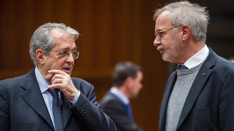 Italy's Finance Minister Fabrizio Saccomanni, left, talks with the President of the European Investment Bank Werner Hoyer at the start of an Ecofin meeting at the European Council building in Brussels, Tuesday Dec. 10, 2013. (AP Photo/Geert Vanden Wijngaert)