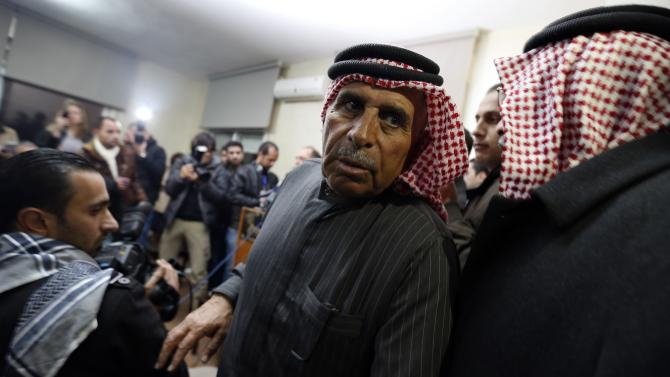 Yousef, father of Islamic State captive Jordanian pilot Kasaesbeh, leaves a news conference where he asked Islamic State to pardon and release his son, in Amman