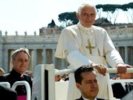 Paolo Gabriele (bottom), the pope's butler, sits in the popemobile next to Pope Benedict XVI in April 2012. The Vatican is hunting for the masterminds of leaks that have enraged the Holy See, with few believing the pope's arrested butler was behind the scandal, Italian media reported on Sunday