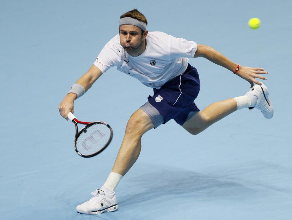Mardy Fish of the U.S. plays a return to Jo-Wilfried Tsonga of France during their round robin singles tennis match against at the ATP World Tour Finals at O2 Arena in London, Tuesday, Nov. 22, 2011. (AP Photo/Kirsty Wigglesworth)