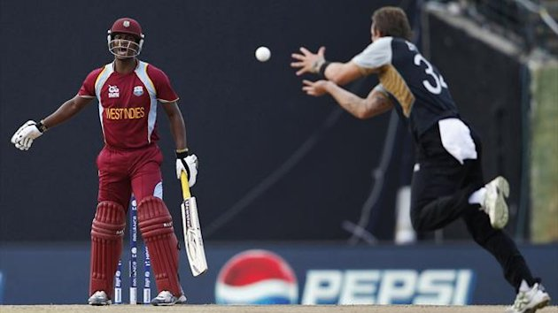 ew Zealand's Doug Bracewell prepares to take the successful catch of West Indies' Johnson Charles (L) during their Twenty20 World Cup Super 8 cricket match in Pallekele October 1, 2012 (Reuters)