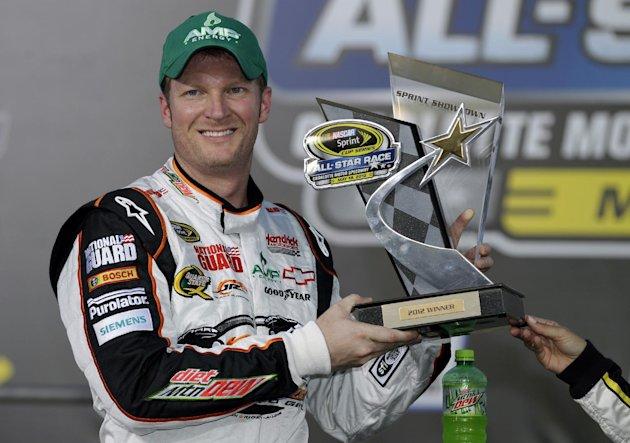 Dale Earnhardt Jr. poses with the trophy in victory lane after winning the NASCAR Sprint Showdown auto race in Concord, N.C., Saturday, May 19, 2012. (AP Photo/Chuck Burton)